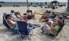 Book club gathering on a beach